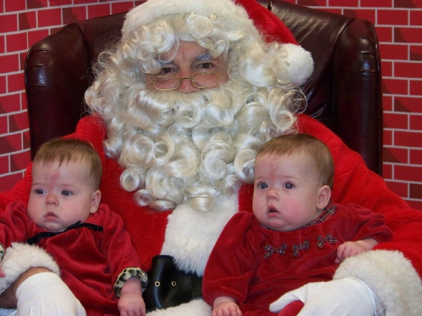 We had to wait for an hour in a very noisy, very overcrowded room, but Carolyn and Elizabeth had their first visit with Santa!